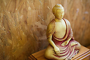 Buddha icon on ledge at the Rivendell Buddhist Retreat Centre, East Sussex, England.