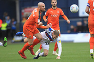 McCormack challenges Matty Done  during the EFL Sky Bet League 1 match between Luton Town and Rochdale at Kenilworth Road, Luton, England on 2 March 2019.