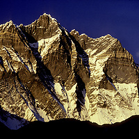 NEPAL, HIMALAYA. Sunset on South Face of 8501-meter Lhotse, 4th highest mountain in the world, Khumbu region.
