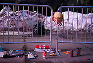 A rubber mask of U.S. President Donald Trump hangs on a fence with other items discarded outside a Trump rally in Des Moines, Iowa, U.S., January 30, 2020. REUTERS/Rick Wilking