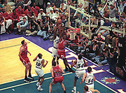June 8, 1997; Salt Lake City, Utah, USA;  Antoine Carr(55) of the Utah Jazz tries to steal the ball from Michael Jordan(23) of the Chicago Bulls as Jordan drives to the basket for a dunk during Game 4 of the 1997 NBA Finals at the Delta Center.