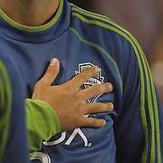 Clint Dempsey, Seattle Sounders, during the National Anthem before the start of the New York Red Bulls Vs Seattle Sounders, Major League Soccer regular season match at Red Bull Arena, Harrison, New Jersey. USA. 20th September 2014. Photo Tim Clayton