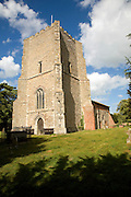 Church of St Mary the large tower dating form the medieval period when the church was much larger, Bawdsey, Suffolk, England