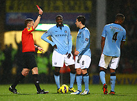 Football - 2012 / 2013 Premier League - Norwich vs. Manchester City<br /> <br /> Referee Mike Jones shows Samir Nasri of Manchester City a red card after an alleged headbutt on Norwich City's Sebastien Bassong at Carrow Road, Norwich