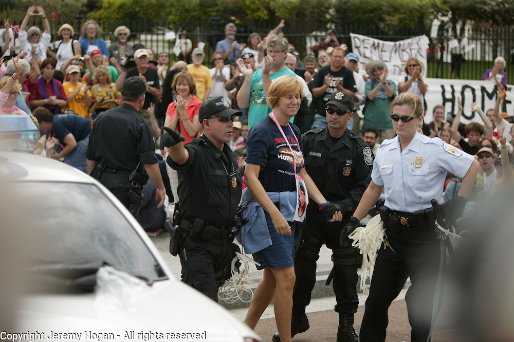"""Anti-war activist Cindy Sheehan is arrested during a """"direct action on the Whitehouse"""" while protesting the war in Iraq."""