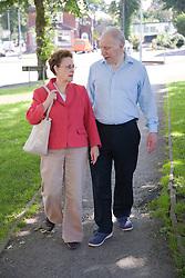 Older couple out walking together,