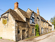 Historic former Red Lion pub in Melksham, Wiltshire, England, UK row cottages Cotswold stone