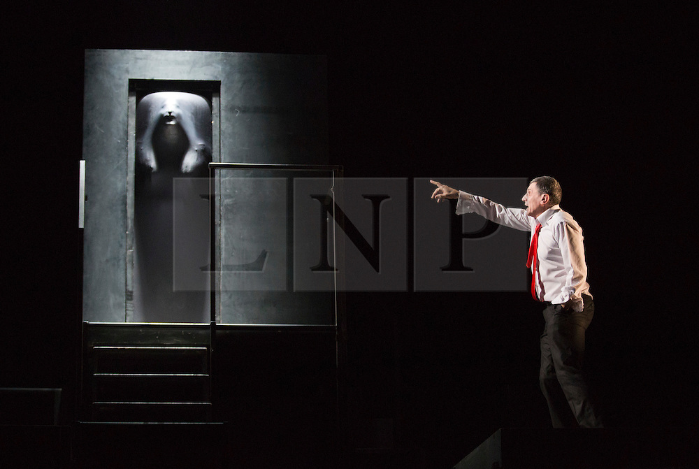 """© Licensed to London News Pictures. 14/02/2013. London, England. Hugues Quester behind door with Sergie Maggiani. The Barbican brings Eugène Ionesco's play """"Rhinocéros"""" by Théâtre de la Ville from Paris to London. In this play, villagers turn into rhinoceri. It warns against totaliarism and the destructive power of the collective. From 14 to 16 February 2013. Photo credit: Bettina Strenske/LNP"""