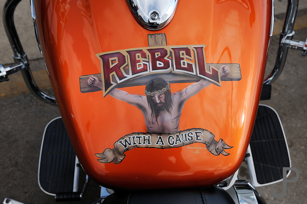 Custom gas tank painting for a Christian Motorcycle Association member