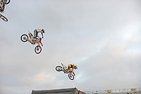 """Cowboy Kenny and his fellow riders soar through the air in their finale at Friday's """"Fight Hunger Night"""" events at the California Rodeo Salinas."""