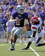 MANHATTAN, KS - SEPTEMBER 27:  Quarterback Josh Freeman #1 of the Kansas State Wildcats scrambles away from defensive end Nate Douglas #58 of the  Louisiana-Lafayette Ragin' Cajuns in the second quarter on September 27, 2008 at Bill Snyder Family Stadium in Manhattan, Kansas.  Kansas State defeated Louisiana-Lafayette 45-37.