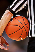 SHOT 1/21/12 5:49:42 PM - A referee holds a basketball during a timeout as Colorado plays Arizona during their PAC 12 regular season men's basketball game at the Coors Events Center in Boulder, Co. Colorado won the game 64-63..(Photo by Marc Piscotty / © 2012)