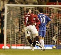 Photo: Aidan Ellis.<br /> Manchester United v Chelsea. The Barclays Premiership. 26/11/2006.<br /> United's Wayne Rooney congratulates 1st goal scorer Loius Saha
