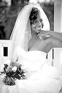 Black and white picture taken with beautiful bride and her veil on a gazebo at sunset.