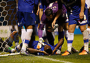 Gillingham players check on their team mate Emmanuel Osadebe after he is kicked in the face during the Sky Bet League 1 match between Gillingham and Bury at the MEMS Priestfield Stadium, Gillingham, England on 14 November 2015. Photo by Andy Walter.