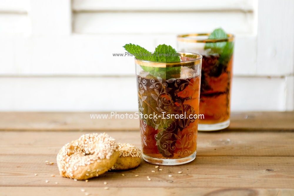 Glass of mint tea, close-up with savoury biscuits