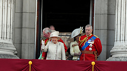 Queen Elizabeth ll stands on the balcony of Buckingham Palace with Prince Charles, Prince of Wales, Catherine, Duchess of Cambridge and Prince Andrew, Duke of York following Trooping the Colour in London
