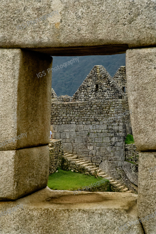 Looking through one of the windows in the Temple of the 3 Windows at the Inca ruins of Machu Picchu