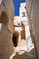The medieval narrow streets of Ostuni, The White Town, Puglia, Italy. .<br /> <br /> Visit our ITALY HISTORIC PLACES PHOTO COLLECTION for more   photos of Italy to download or buy as prints https://funkystock.photoshelter.com/gallery-collection/2b-Pictures-Images-of-Italy-Photos-of-Italian-Historic-Landmark-Sites/C0000qxA2zGFjd_k<br /> .<br /> <br /> Visit our MEDIEVAL PHOTO COLLECTIONS for more   photos  to download or buy as prints https://funkystock.photoshelter.com/gallery-collection/Medieval-Middle-Ages-Historic-Places-Arcaeological-Sites-Pictures-Images-of/C0000B5ZA54_WD0s