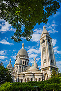 The Basilica of the Sacred Heart of Paris, commonly known as Sacré-Cœur Basilica (French: Basilique du Sacré-Cœur, pronounced [sakʁe kœʁ]), is a Roman Catholic church and minor basilica, dedicated to the Sacred Heart of Jesus, in Paris, France. A popular landmark, the basilica is located at the summit of the butte Montmartre, the highest point in the city. Sacré-Cœur is a double monument, political and cultural, both a national penance for the supposed excesses of the Second Empire and socialist Paris Commune of 1871[1] crowning its most rebellious neighborhood, and an embodiment of conservative moral order, publicly dedicated to the Sacred Heart of Jesus, which was an increasingly popular vision of a loving and sympathetic Christ.