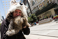 A man dressed as a wolf called 'Shadow' poses on Bourke Street Mall during Black Friday sales in the CBD.  As temperatures soured in Melbourne, locals flock to the city for Christmas bargains. Victoria saw its 29th day of no cases today but despite this the government show no signs of further lifting of restrictions. (Photo by Dave Hewison/Speed Media)