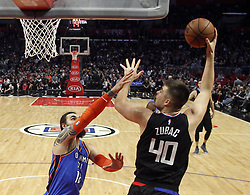 March 8, 2019 - Los Angeles, California, U.S - Los Angeles Clippers' Ivica Zubac (40) shoots while defended by Oklahoma City Thunder's Steven Adams (12) during an NBA basketball game between Los Angeles Clippers and Oklahoma City Thunder Friday, March 8, 2019, in Los Angeles. (Credit Image: © Ringo Chiu/ZUMA Wire)