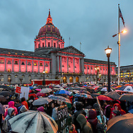 San Francisco City Hall's pink lights surprise the crowd, turning on just as the crowd begins to march from the rally at Civic Center Plaza.