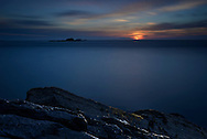 Sunset overlooking the Skerries near St David's and Ramsey Island, Pembrokeshire, Wales
