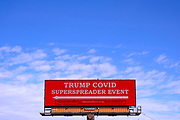 "14 OCTOBER 2020 - DES MOINES, IOWA: An electronic in front of the Des Moines airport welcomes people to the ""Trump COVID SuperSpreader Event."" President Donald Trump has been criticized for his handling of the COVID-19 pandemic. The sign was paid for by Rural America 2020. Trump, who is recovering from COVID-19 is hosting a campaign event at the Des Moines airport.       PHOTO BY JACK KURTZ"