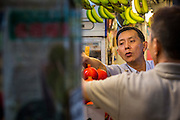 18 DECEMBER 2012 - SINGAPORE, SINGAPORE: A vendor sorts and stacks fresh fruit in Tekka Market in the Little India section of Singapore.    PHOTO BY JACK KURTZ