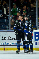 KELOWNA, BC - JANUARY 3: Kaid Oliver #34 and Gary Haden #23 of the Victoria Royals celebrate a first period goal against the Kelowna Rockets at Prospera Place on January 3, 2020 in Kelowna, Canada. (Photo by Marissa Baecker/Shoot the Breeze)