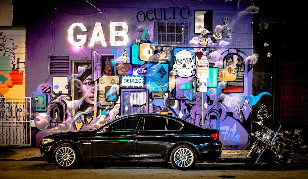 A night streetscape in Miami's Wynwood district somehow resembles a stage set.