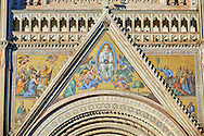 Close up of the main door with mosaics depicting the the Virgin Mary created between 1350 and 1390 after designs by artist Cesare Nebbia  on the14th century Tuscan Gothic style facade of the Cathedral of Orvieto, designed by Maitani, Umbria, Italy .<br /> <br /> Visit our ITALY HISTORIC PLACES PHOTO COLLECTION for more   photos of Italy to download or buy as prints https://funkystock.photoshelter.com/gallery-collection/2b-Pictures-Images-of-Italy-Photos-of-Italian-Historic-Landmark-Sites/C0000qxA2zGFjd_k<br /> .<br /> <br /> Visit our MEDIEVAL PHOTO COLLECTIONS for more   photos  to download or buy as prints https://funkystock.photoshelter.com/gallery-collection/Medieval-Middle-Ages-Historic-Places-Arcaeological-Sites-Pictures-Images-of/C0000B5ZA54_WD0s