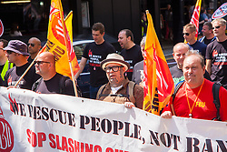London, June 21st 2014. Members of the Fire Brigades Union participate in the march against auserity.