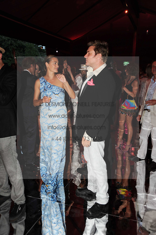 SIMON & YASMIN LE BON at the annual Serpentine Gallery Summer party this year sponsored by Jaguar held at the Serpentine Gallery, Kensington Gardens, London on 8th July 2010.  2010 marks the 40th anniversary of the Serpentine Gallery and the 10th Pavilion.