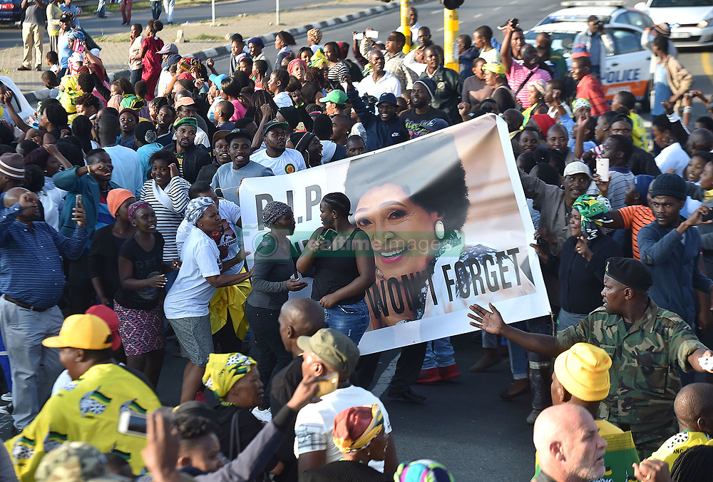 204<br /> 13.04.2018<br /> Mourners carry a portrait of the late struggle icon Winnie Madikizela-Mandela as they wait to view her coffin, the coffin was collect by her family at Kupane Funeral Parlour to be taken to her home in Orlando West' Soweto.<br /> Picture: Itumeleng English/ African News Agency(ANA)