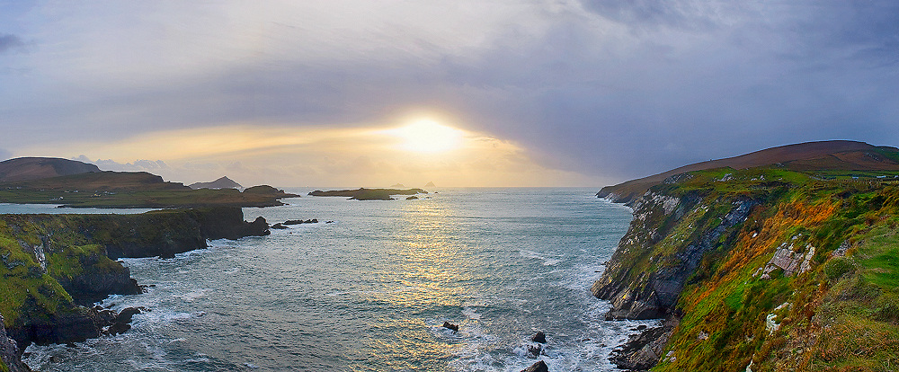 Panoramic Valentia Island Cliffs with view on Great Skelligs by Sunset, Couny Kerry, Ireland / vl070 I love the Skelligs, ****** <br /> <br /> Visit & browse through my Photography & Art Gallery, located on the Wild Atlantic Way & Skellig Ring between Waterville and Ballinskelligs (Skellig Coast R567), only 3 minutes from the main Ring of Kerry road.<br /> https://goo.gl/maps/syg6bd3KQtw<br /> <br /> ******<br /> <br /> Contact: 085 7803273 from an Irish mobile phone or +353 85 7803273 from an international mobile phone