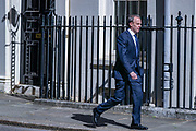 Britain's Foreign Secretary Dominic Raab arrives at Downing Street in London, Tuesday, May 12, 2020. For most people, the new coronavirus causes only mild or moderate symptoms, such as fever and cough. For some, especially older adults and people with existing health problems, it can cause more severe illness, including pneumonia. (Photo/ Vudi Xhymshiti)