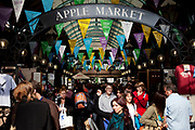 Apple Market at the heart of Covent Garden in the West End of London. This indoor area has restaurants and stalls for tourists to visit.