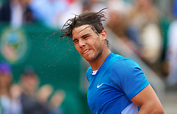 MONTE-CARLO, MONACO - Saturday, April 17, 2010: Rafael Nadal (ESP) takes off his bandana and shakes the sweat from his head after his 6-2, 6-3 victory during the Men's Singles Semi-Final on day six of the ATP Masters Series Monte-Carlo at the Monte-Carlo Country Club. (Photo by David Rawcliffe/Propaganda)