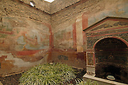 The well frescos and fountain at the House of the small fountain, Casa Della fontana piccola, the ruins at Pompeii, Campania, Italy under the Vesuvius volcano, July 2006