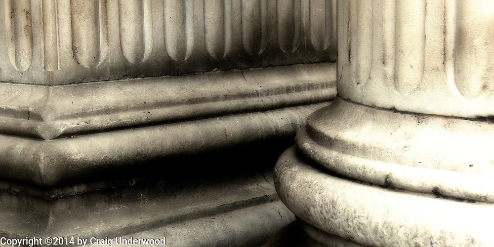 Two pillars, one square and one round, at the entrance of St Paul's Cathedral in London.  Dating from the late 17th century it Miraculously survived the German Blitz of WWII.