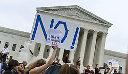 October 6, 2018 - Washington, District of Columbia, U.S - Protesters gather in opposition on the steps of the Supreme Court of the United States after Brett Kavanaugh was sworn in as Associate Justice of the United States on October 6, 2018. (Credit Image: © Leigh VogelZUMA Wire)