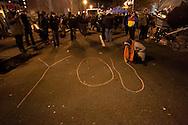 "Boston, MA 12/09/2011.An Occupy Boston protestor writes ""You are loved"" in chalk on Atlantic Avenue early Friday morning..Alex Jones / www.alexjonesphoto.com"
