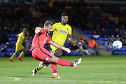 AFC Wimbledon striker Lyle Taylor (33) puts Peterborough United goalkeeper Ben Alnwick (1) under pressure during the EFL Cup match between Peterborough United and AFC Wimbledon at ABAX Stadium, Peterborough, England on 9 August 2016. Photo by Stuart Butcher.