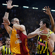 Galatasaray's Ermal KURTOGLU (L) and Fenerbahce Ulker's Darjus LAVRINOVIC (R) during their Turkish Basketball league Play Off Final fourth leg match Galatasaray between Fenerbahce Ulker at the Abdi Ipekci Arena in Istanbul Turkey on Saturday 11 June 2011. Photo by TURKPIX