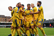 Players celebrate goal during the EFL Sky Bet League 1 match between Southend United and AFC Wimbledon at Roots Hall, Southend, England on 12 October 2019.