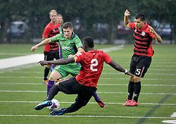 24 June 2015. New Orleans, Louisiana.<br /> National Premier Soccer League. NPSL. <br /> Jesters 0 - Atlanta Silverbacks 1.<br /> The New Orleans Jesters lose 0-1 to the Atlanta Silverbacks in a lightning delayed game at home in the Pan American Stadium. <br /> Photo©; Charlie Varley/varleypix.com
