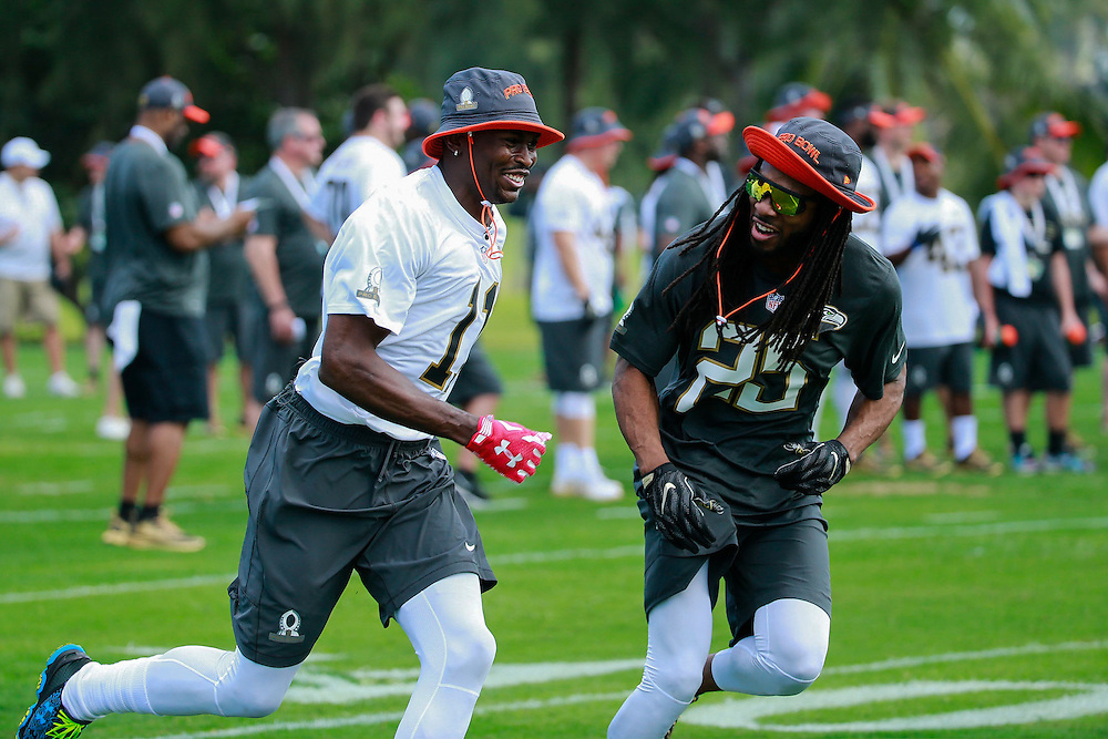 January 28 2016: Atlanta Falcons Julio Jones and Seattle Seahawks Richard Sherman have some fun during the Pro Bowl practice at Turtle Bay Resort on North Shore Oahu, HI. (Photo by Aric Becker/Icon Sportswire)