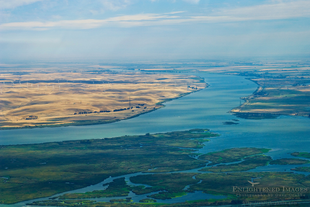 Aerial over the Sacramento River and the Montezuma Hills Wind Farm, Solano County, California